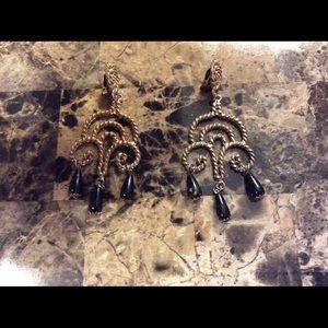 Goldtone and black chandelier design earrings.